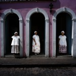 Brazil, Cachoeira, Salvador da Bahia. Three Irmanas (Sisters) stand at the entrance to the seat of the Irmandade da Boa Morte (Sisterhood of the Good Death).