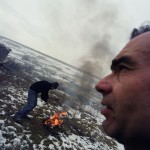 Romania, Bucharest. Joan and Florin burn electric cables for later sell the copper.