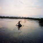 Romania, Bucharest. Florin returns from fishing.