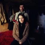 Romania, Bucharest. Alina and Sorin inside their shack.