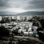 Greece, Patras. A refugee shantytown next to citizens' housing in the port of Patras. Patras is home to about 3,000 illegal immigrants.
