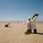 Mozambique,Maputo. Adherents from a Zion church pray together during a purification ceremony on a beach.