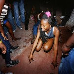 Angola, Luanda. A young girl dancing to Kuduru/Kuduro music at a disco.