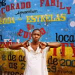 Angola,Luanda. A Kuduru/Kuduro musician stands outside his studio in the Sambizanga musseque (slum) near Luanda's airport.
