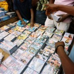 Angola, Luanda. Kuduru/Kuduro CDs being sold in Luanda's Roque Santeiro market.