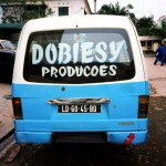 Angola, Luanda. A Candongueiro (communal taxi), parked in a Luanda street, displays the logo of Dobiesy Productions, producers of Kuduru/Kuduro music.
