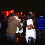 Angola, Luanda. Young couples dance together at Luanda club Esplanada 10 on a Saturday night.