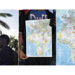 A triptych of Gabriel, 24, from Eritrea holding a map showing the route he travelled from Asmara to Sicily.